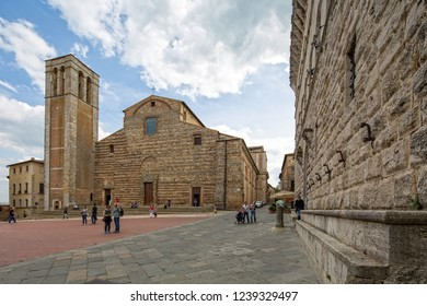Montepulciano, Tuscany/Italy - May 09 2016: Tourists and local people on the Piazza. At the highest point of the town in Montepulciano stands the Duomo, named after Santa Maria Assunta