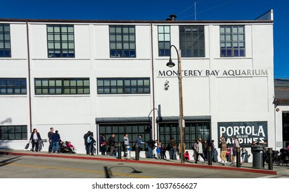 Monterey, CA - February 18, 2018. People line up in front of Monterey Bay Aquarium waiting for it to open on a sunday morning. Lines to enter the aquarium are common on the weekeneds.