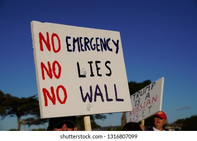 Monterey, CA – February 18, 2019: Protesters demonstrating their opposition to President Trump's declaration of a national emergency in order to move forward with his southern border wall construction