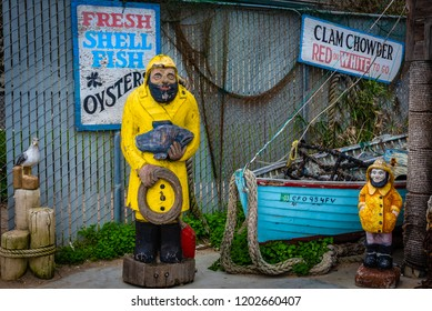 Monterey, California - January 10, 2016:  The entrance of Phil's Fish House and Eatery is decorated with nautical items, including wooden statues of fisherman and a colorful blue boat.