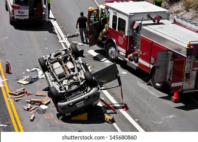 MONTEREY, CALIFORNIA - JUNE 29: The scene of a traffic accident on June 29, 2013,  involving an overturned sport utility vehicle.