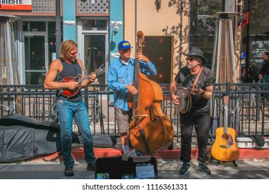 Monterey, California - May 25, 2018: Bluegrass Folk Band Busking on the Street at a Farmer's Market