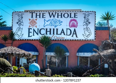 Monterey, California - October 16, 2018: The Whole Enchilada is a popular Mexican food restaurant in Moss Landing, along Highway 1 along the Pacific Coast of the Monterey Bay in central California.
