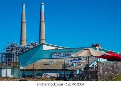 Monterey, California - October 16, 2018: Phil's Fish Market and Eatery is a popular seafood restaurant located on the beachfront at Moss Landing Harbor and Marina.