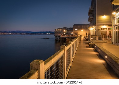 MONTEREY, CALIFORNIA, UNITED STATES, November 21, 2015: A twilight waterfront scene along Cannery Row in Monterey, California.