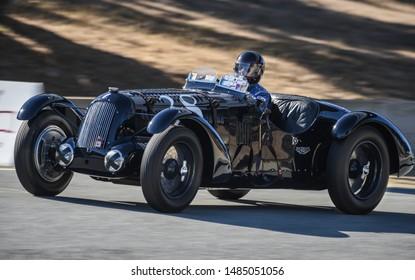 Monterey, California, USA - August 16, 2019: A beautiful black 1936 Talbot Lago T26 race car on-track in the Rolex Monterey Motorsports Reunion at the WeatherTech Laguna Seca Raceway.
