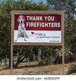Monterey, California, USA - August 2. 2016: An SPCA sign with dog wearing fireman's hat thanks firefighters for their hard work fighting the spreading Soberanes fire, near Carmel Valley and Big Sur.