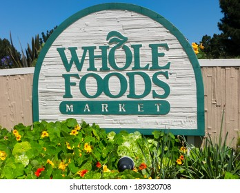 MONTEREY, CA/USA - APRIL 10, 2014:  Whole Food Market exterior sign.  Whole Foods is an American foods supermarket chain specializing in natural and organic foods.