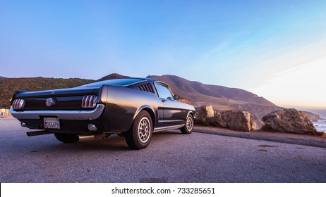 Monterey, USA - January 11 2012: An old Ford Mustang parked at the Pacific Coast in Big Sur, Monterey.