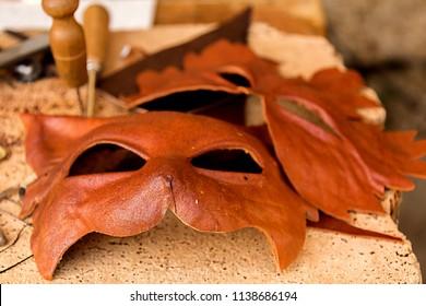 Monteriggioni, Italy, Tuscany 07/14/2018, close up of leather craft masks