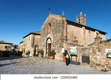 MONTERIGGIONI, SIENA, ITALY - JANUARY 7, 2017: Church of Santa Maria Assunta (XIII century) in the ancient medieval village of Monteriggioni, Siena, Tuscany, Italy, Europe