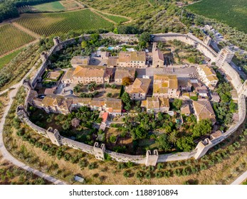 Monteriggioni is a walled town in Tuscany, Italy, known for its medieval fortifications and watchtowers., aerial view.