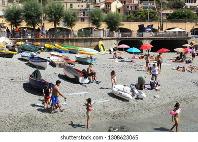 MONTEROSSO AL MARE, ITALY-AUG. 16, 2017: Vacationers enjoy the beach at this popular town in the Cinque Terre National Park.