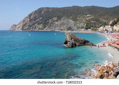Monterosso al Mare, view of private beach with sea rock. Cinque Terre, Italy