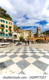 MONTEROSSO, CINQUE TERRE - ITALY, MAY 12, 2019: Typical Italian coastal town, square and colorful houses, walking people