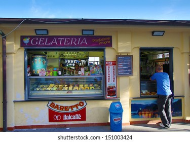 MONTEROSSO - ITALY: AUG 17: A man orders ice cream from a gelato stand along the coast of Cinque Terre in Monterosso, Italy, on Sunday, August 17, 2013.