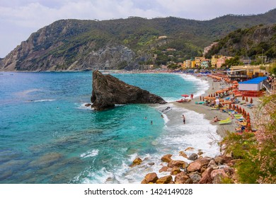 MONTEROSSO, ITALY - June 2019: Aerial view of Fegina beach in Monterosso, people on the bach, Cinque Terre, Liguria, Italy