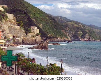 MONTEROSSO, ITALY-SEPTEMBER 26: The beach, waterfront and old town is seen in Cinque Terre, Monterosso, Italy on September 26, 2016 with town of Vernazza in the distance.