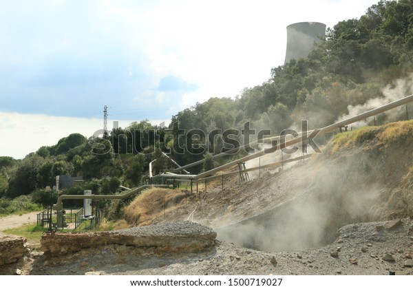 Monterotondo, Larderello, Tuscany, Italy.  Geothermal field with fumaroles and steam pipes. Geothermal power station.Condensation towers in reinforced concrete.