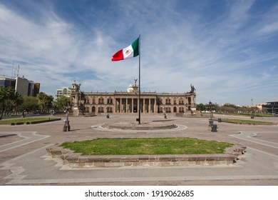 Monterrey, Mexico - 12 February 2021: Flag of Mexico with national palace of the Macroplaza of Monterrey