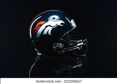 MONTERREY, NL, MEXICO - 04 NOVEMBER 2018 - Denver Broncos NFL club riddell helmet replica on black background, product shot.