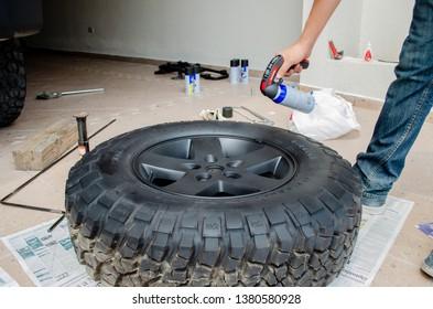 Monterrey Nuevo Leon, Mexico. April 24, 2013.  Covering black plastic wheels. Jeep rubicon.