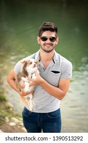 Monterrey Nuevo Leon, Mexico. April 23, 2019. Attractive young man posing  outdoors holding a cute small dog.