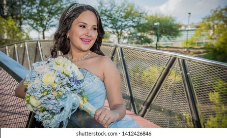 """Monterrey Nuevo Leon, Mexico. April 24, 2016. """" Quinceañera"""" photography session in a park.  Ligth blue long dress."""