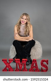 Monterrey Nuevo Leon Mexico. December 17, 2019.  Attractive woman 40 years old,  poses for a Christmas photo session.
