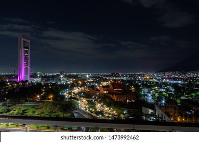 MONTERREY, NUEVO LEON / MEXICO - July 12, 2019: A night shot of the river walk in Monterrey with the Torre Ciudadana in the background.
