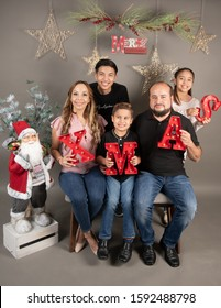 Monterrey Nuevo Leon, Mexico. November 30, 2019 .  Latin family posing for a christmas photography session indoor.