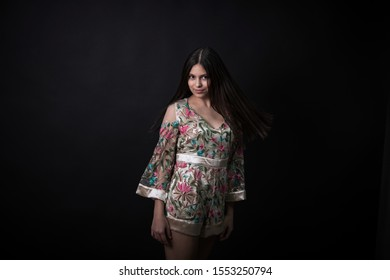 Monterrey Nuevo Leon, Mexico. October 17, 2019.   Latin teen girl posing with a colorful outfit. Brunette beauty long hair.