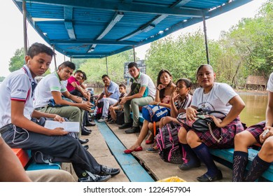 MONTERRICO, GUATEMALA - MARCH 31, 2016: Pople travling on a ferry in the wetlands of the wildlife reserve Biotopo Monterrico-Hawaii, Guatemala