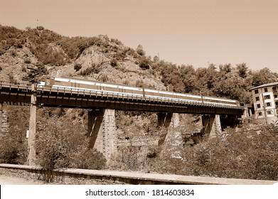 Montesquiu (Barcelona, Spain). 07/15/2007. Commuter train crossing the metal bridge in the district of La Farga de Bebie