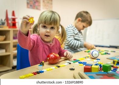 Montessori class, kids are playing and learning