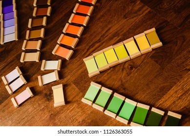 Montessori color tablets on wooden floor background