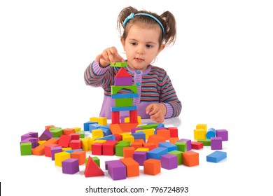 Montessori concept with cute girl playing wooden cubes isolated on white background.