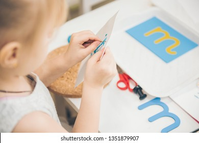 Montessori Education. Montessori School. Learning materials in a Montessori methodology school. Learning letters. Letters to learn to write and read.