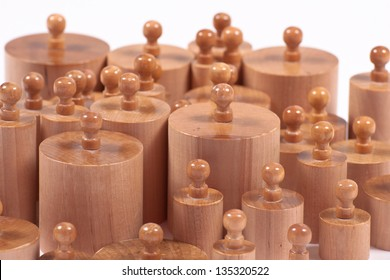 Montessori educational material: wooden cylinders