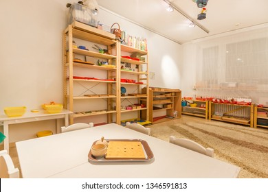 Montessori Kindergarten Preschool Classroom. Table for classes on foreground