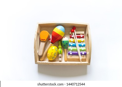 Montessori material to study music. Natural material. White background. Musical instrument on a tray for a lesson.