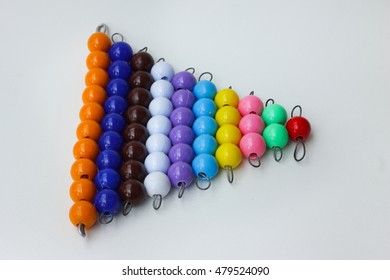 Montessori material - Tens beads on white background.