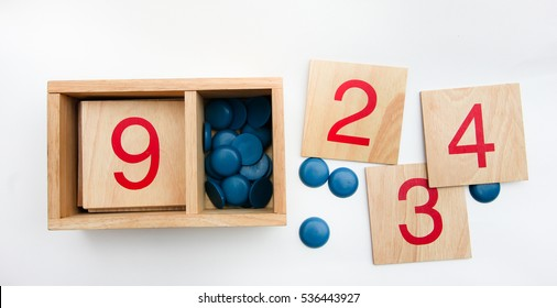 montessori materials - Cards and counting on white background.