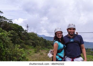 Monteverde, Costa Rica - May 29 : young adventurous couple smiling after a zip line adventure. May 29 2016, Monteverde, Costa Rica.
