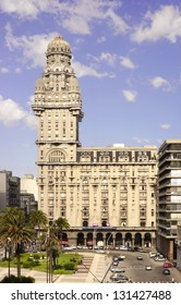 """MONTEVIDEO, URUGUAY - CIRCA DECEMBER 2012:  The """"Palacio Salvo"""" , the most iconic building of  the city is located on the """"Plaza Independencia"""" (Independencia Square)."""