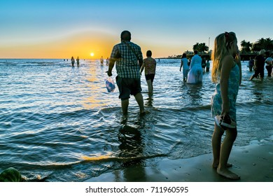 MONTEVIDEO, URUGUAY, FEBRAURY - 2016 - Sunset summer scene at crowded beach at iemanja worship celebration in Montevideo city, Uruguay