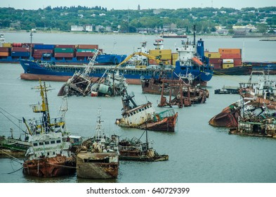MONTEVIDEO, URUGUAY - FEBRUARY 18, 2017: Illegal fishing boats captured in coastal waters are stranded and left to rust in the ship's graveyard in the capital city's harbor when are not paid.