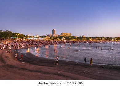 MONTEVIDEO, URUGUAY, FEBRUARY - 2016 - Crowded beach at iemanja worship celebration in Montevideo city, Uruguay