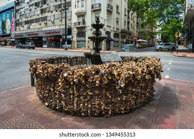 Montevideo, Uruguay – January 1, 2018: Love Locks Fountain in Montevideo is a stone fountain on a street corner in Montevideo, the hundreds of padlocks attached to its surrounding railing.
