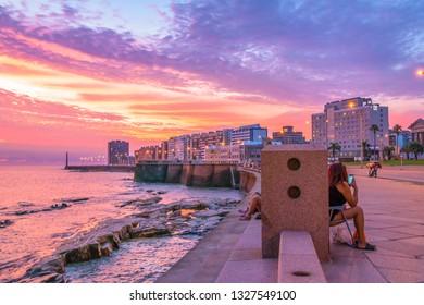 MONTEVIDEO, URUGUAY, JANUARY - 2018 - Beautiful urban coastal sunset scene at rambla sur, one of the boardwalks of montevideo city, uruguay